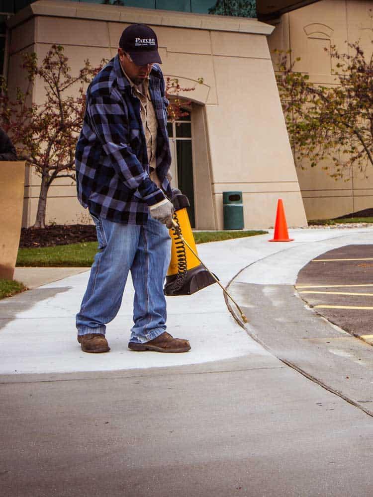 244-Salt-Screen-Additive-applied-to-sidewalk