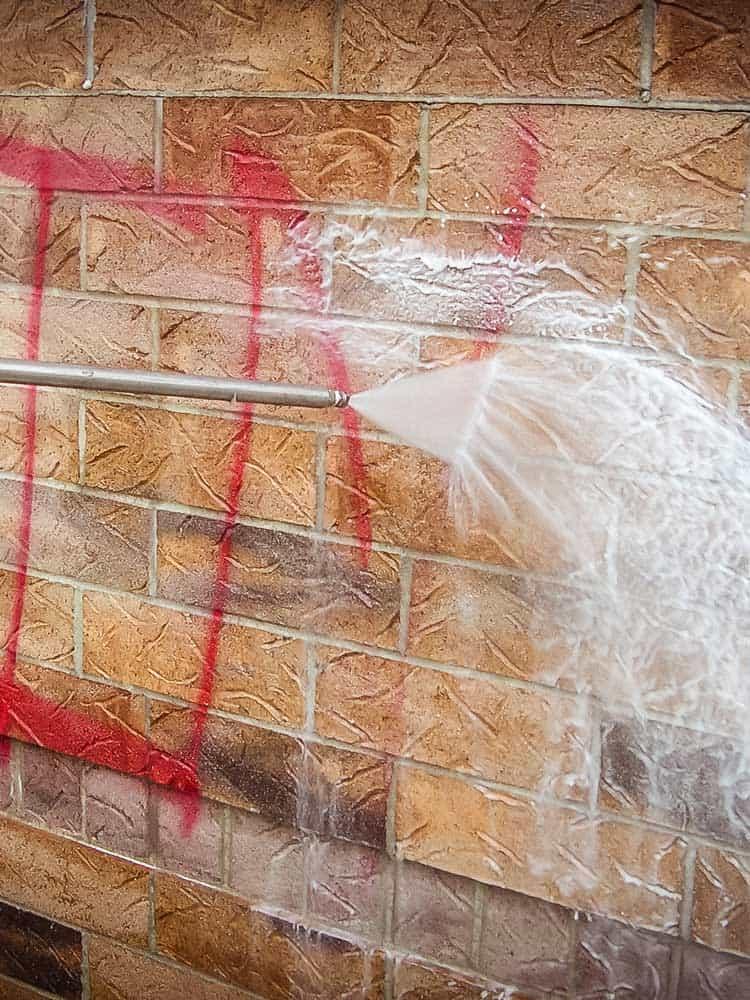Graffiti-Remover-removing-graffiti-tag