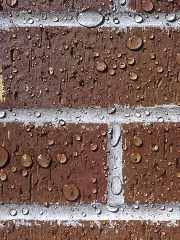 water-beads-on-red-brick