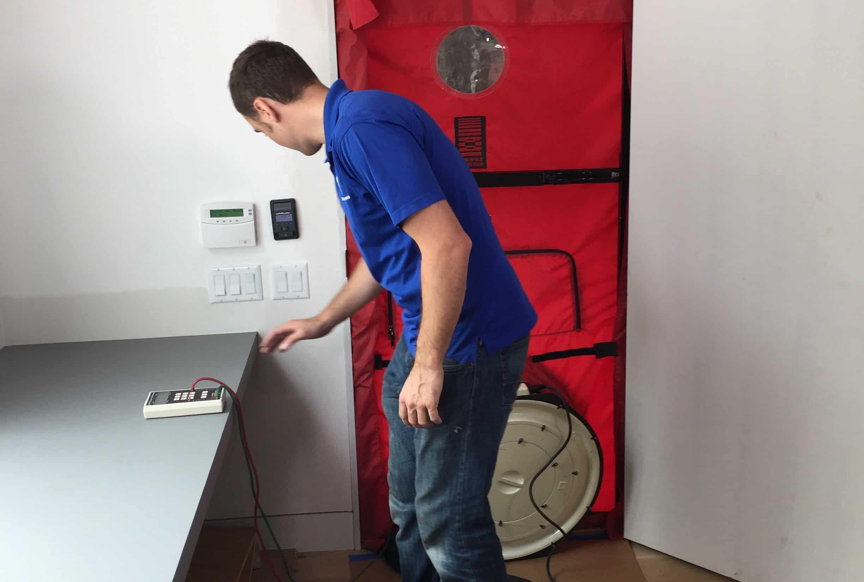 Blower door test in progress.