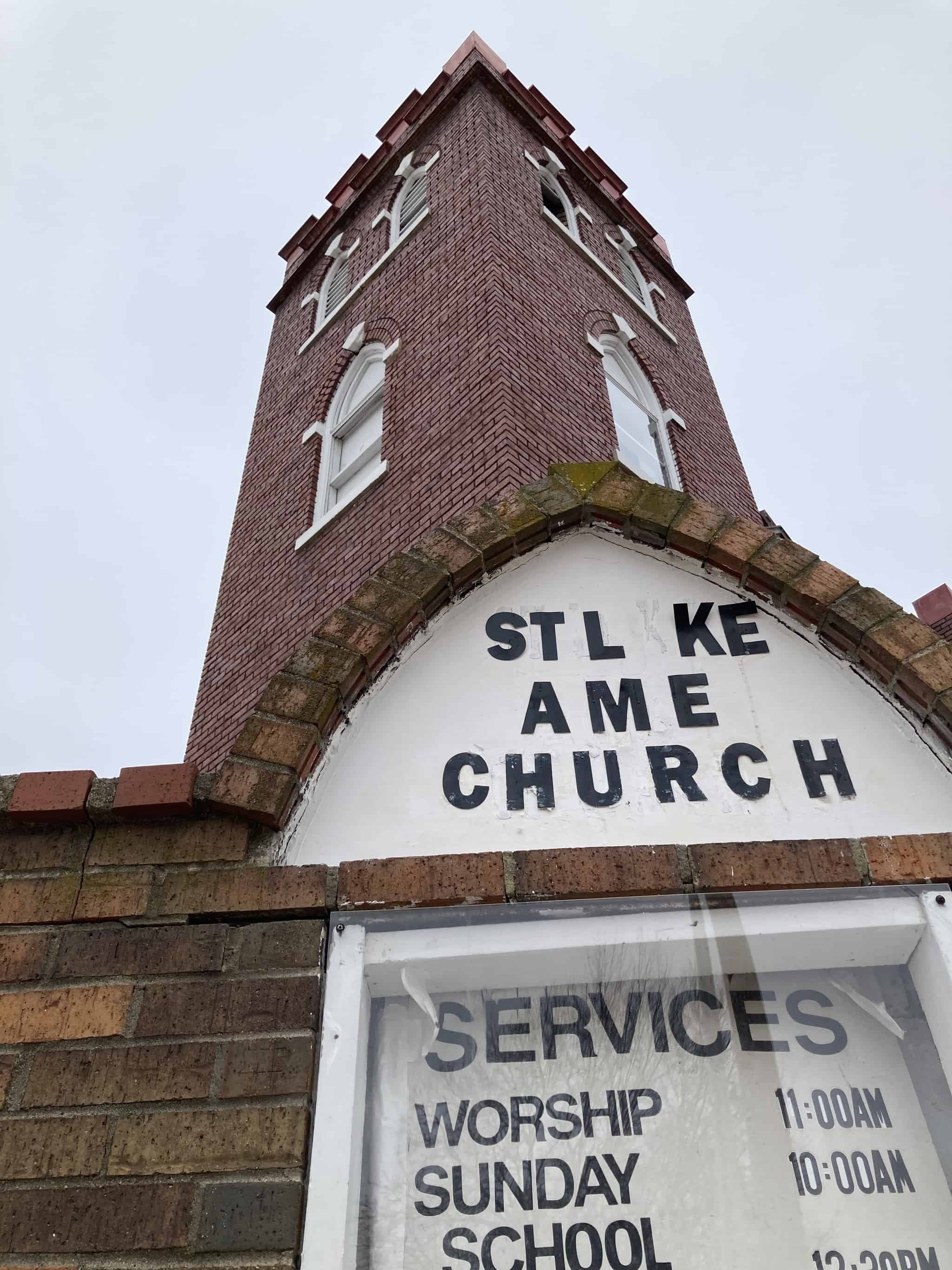 Built in 1910 at the corner of New York Street and Ninth Street in Lawrence, Kansas, the Gothic-Revival, red-brick church features twin towers, lancet windows and stained glass.