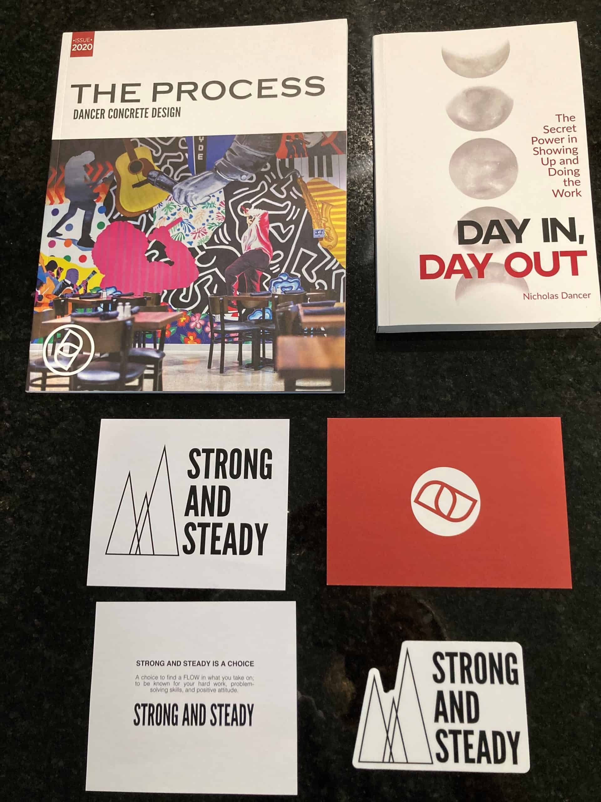 Pictured are some of Dancer Concrete's marketing materials and Dancer's own book published in 2019.