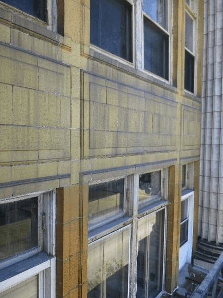 Trials would determine the best solutions to remove the atmospheric stains, biological growth and efflorescence off the facade. Photo courtesy WJE